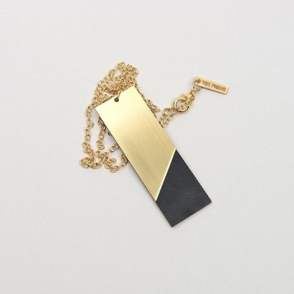 Form necklace in black and brass. Handmade by Scottish studio Tom Pigeon